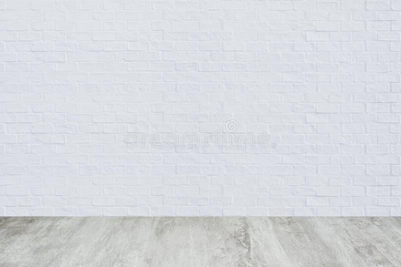 Witte bakstenen muur met de textuurachtergrond van de cementvloer stock fotografie