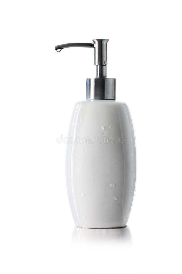Witte ceramische fles met automaatpomp voor vloeibare zeep, shampo stock foto's