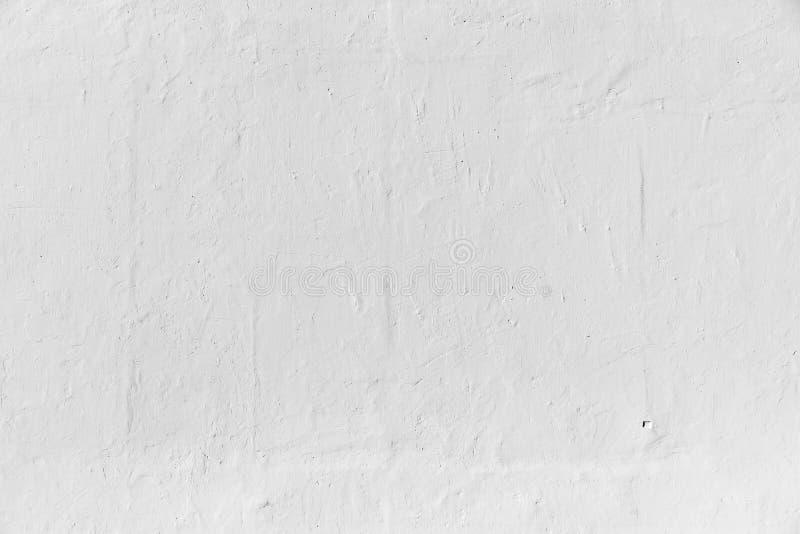 Witte concrete muurtextuur met hulpverf stock afbeeldingen