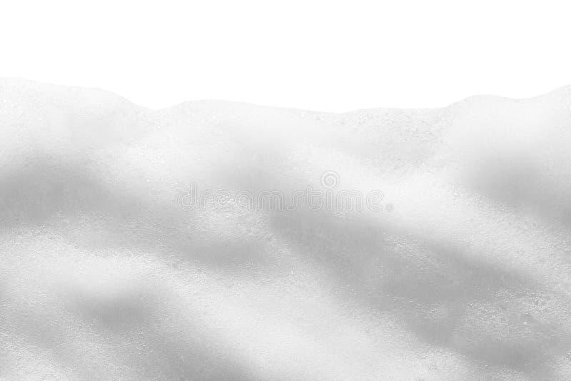 Witte die schuimtextuur op witte achtergrond wordt geïsoleerd Kosmetisch reinigingsmiddel, zeep, shampoobellen stock foto's