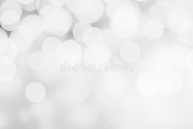 Witte en zilveren abstracte bokehlichten Het fonkelen Kerstmisdefo stock afbeeldingen