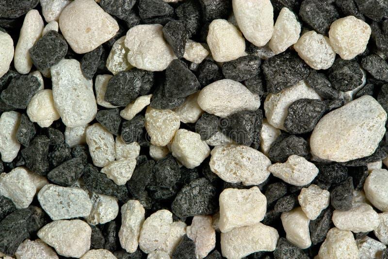 Witte en zwarte rotsen stock afbeeldingen