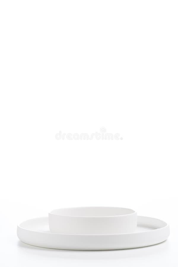 Witte geniete die platen over wit worden geïsoleerd stock afbeeldingen
