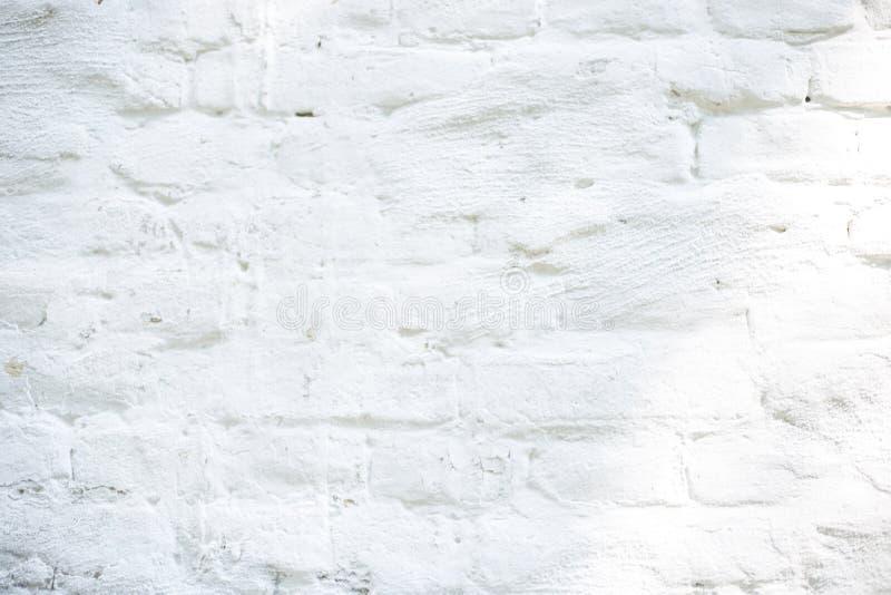 Witte geschilderde bakstenen muur royalty-vrije stock foto's