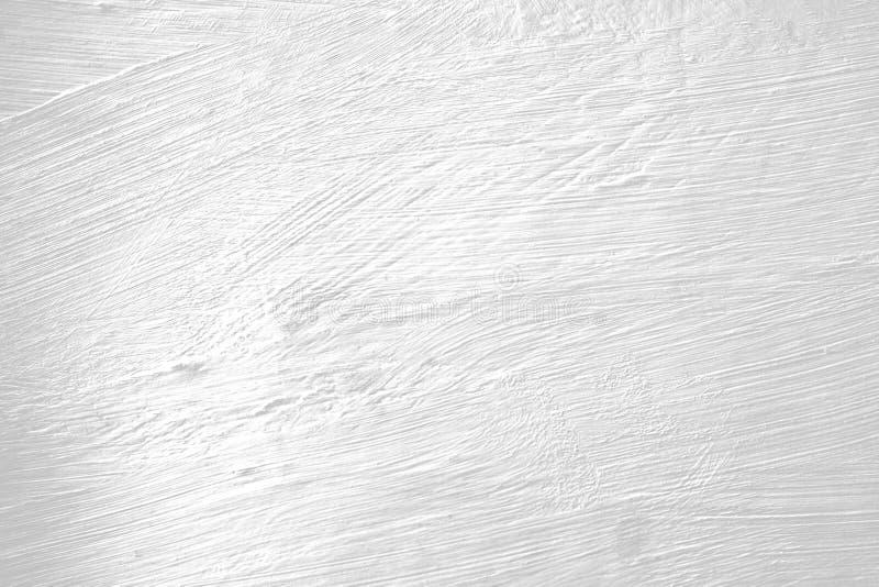 Witte geschilderde muur met borsteltekens royalty-vrije stock foto's