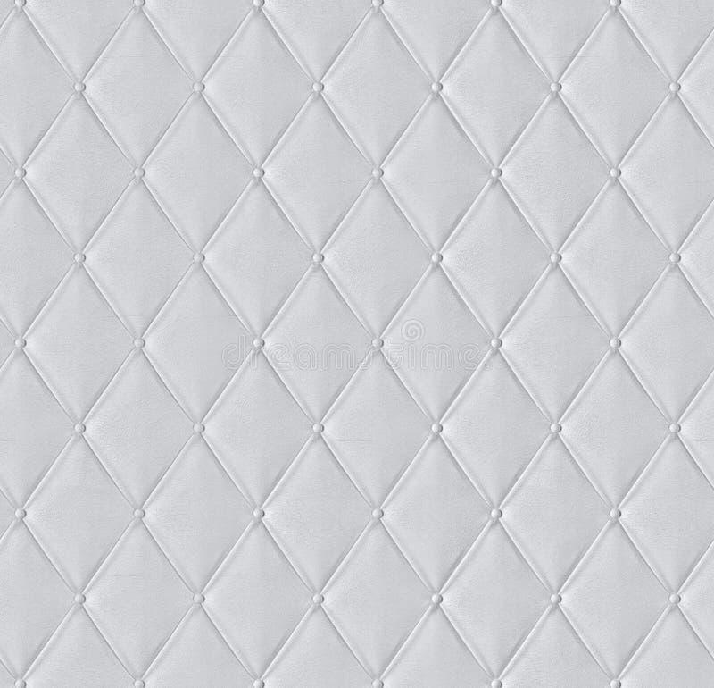 Witte gewatteerde leer betegelde textuur