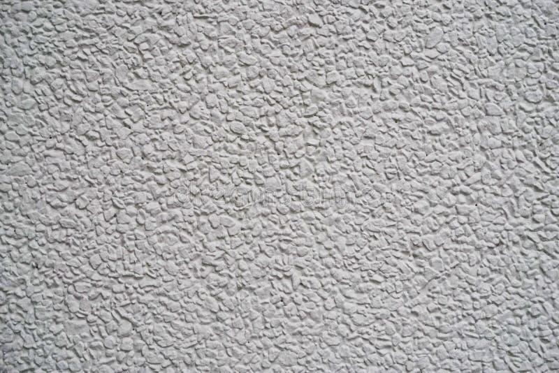 Witte grijze korrelige muurtextuur stock foto's