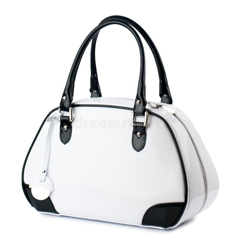 Witte handtas met zwarte handvatten die op witte achtergrond worden geïsoleerd royalty-vrije stock fotografie