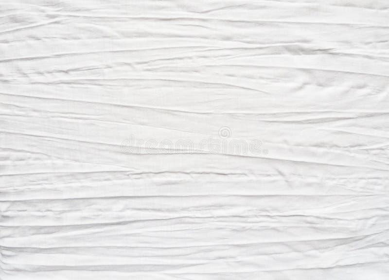 Witte katoenen stof met gevouwen effect stock afbeeldingen