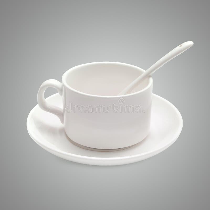 Witte koffiekop met een lepel op de schotel stock foto's