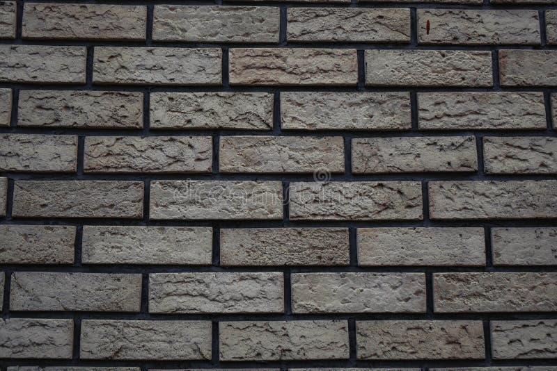 witte muur van bakstenen met een grijze achtergrond van de tintbaksteen royalty-vrije stock afbeeldingen
