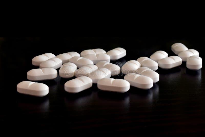 Witte pillen, antibiotica, kalmeringsmiddelen royalty-vrije stock afbeelding