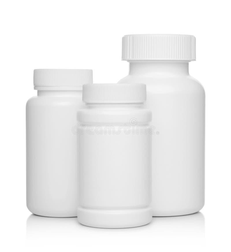 Witte plastic medische containers voor geïsoleerde pillen stock foto