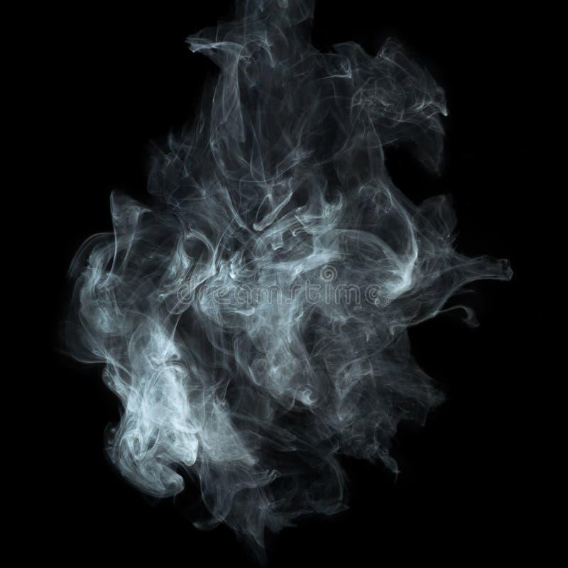 Witte rook op zwarte achtergrond stock foto