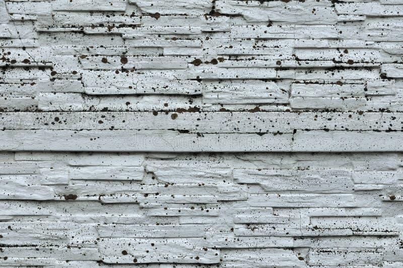 Witte Rustieke Textuur Retro Vergoelijkte Oude Bakstenen muuroppervlakte Uitstekende structuur Grungy Sjofel Ongelijk Geschilderd royalty-vrije stock afbeeldingen