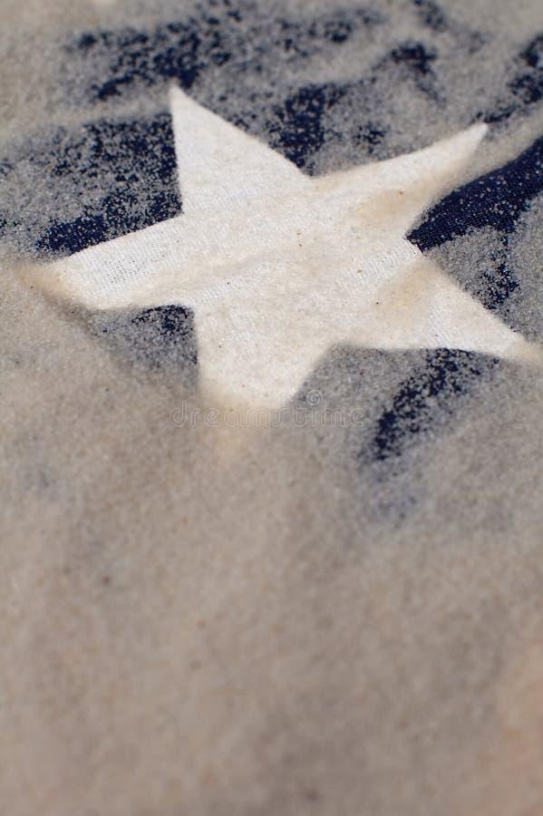 Witte ster in zand royalty-vrije stock afbeeldingen