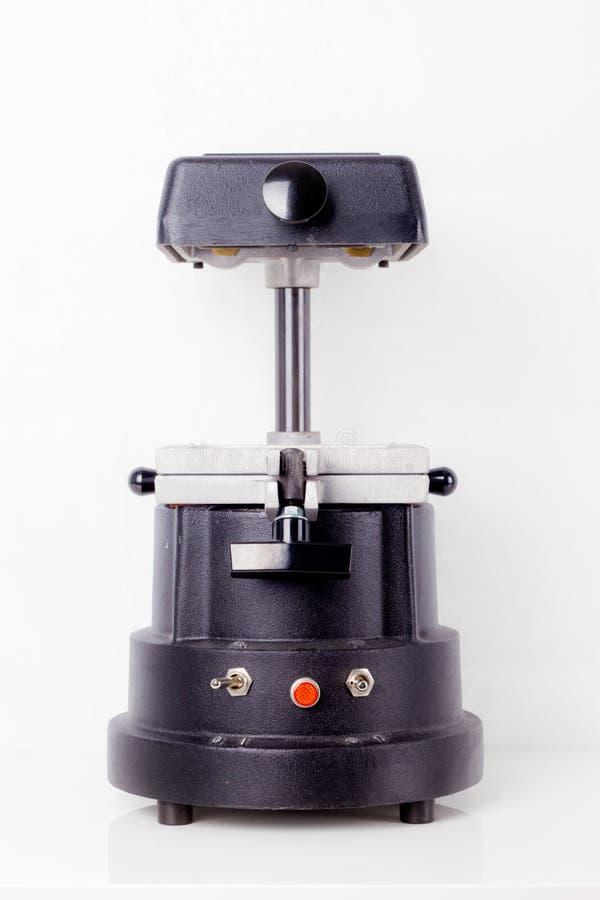 Witte tandartsenmachine royalty-vrije stock afbeelding