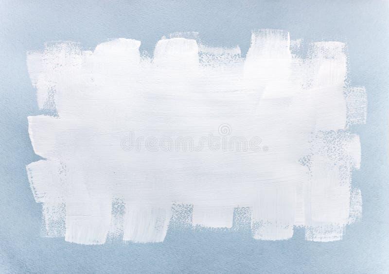 Witte verfkwaststreek over blauw geweven document stock afbeeldingen