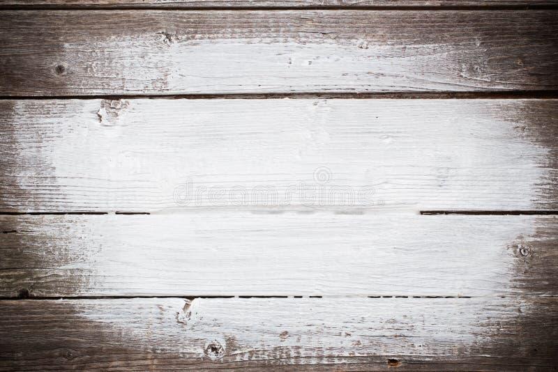 Witte verfslagen op houten plank royalty-vrije stock fotografie