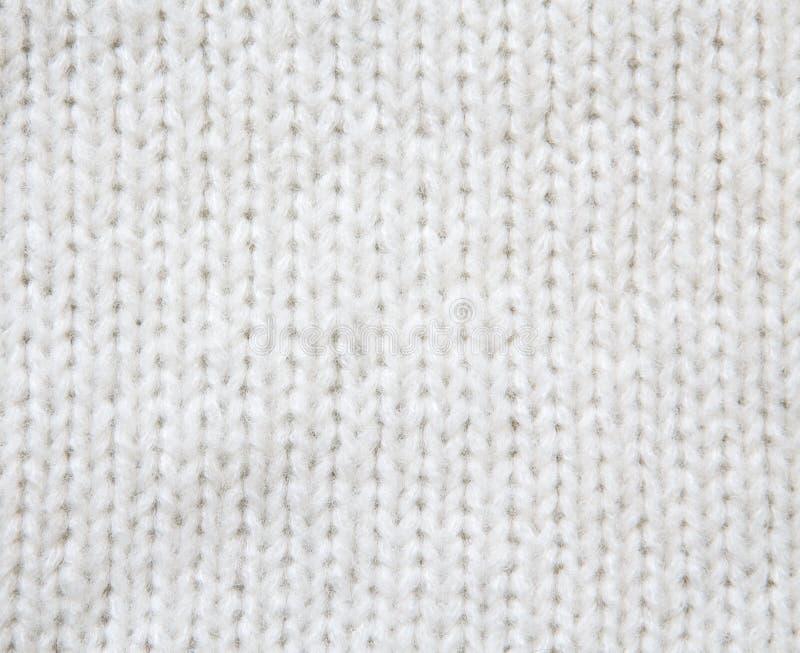 Witte wollen gebreide sweaterachtergrond stock foto's