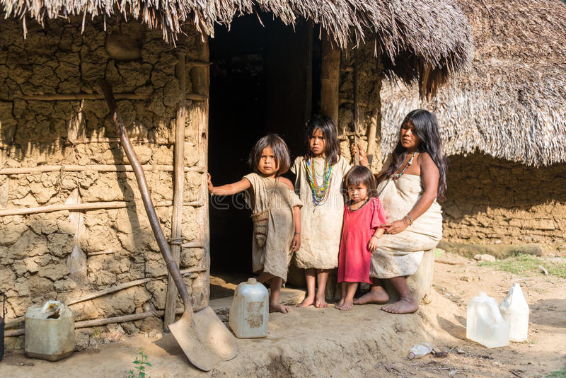 Wiwa Indian Family. MAGDALENA, COLOMBIA - FEBRUARY 6: An indigenous Wiwa family stands in front of their house in the Magdalena Department in Colombia on stock images