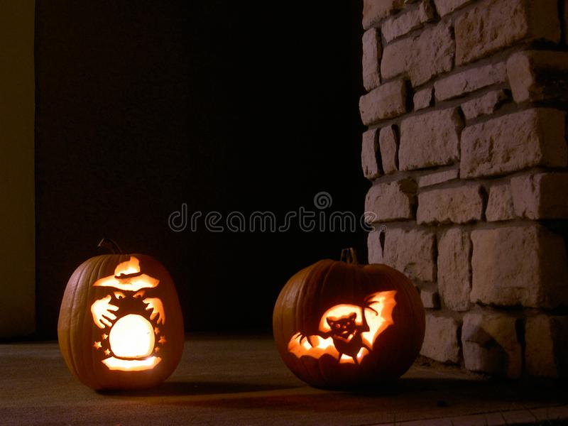 Wizard and bat carved in pumpkins royalty free stock images