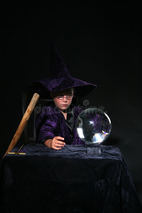 Download Wizard Child With Crystal Ball And Staff Stock Photo - Image: 6274886