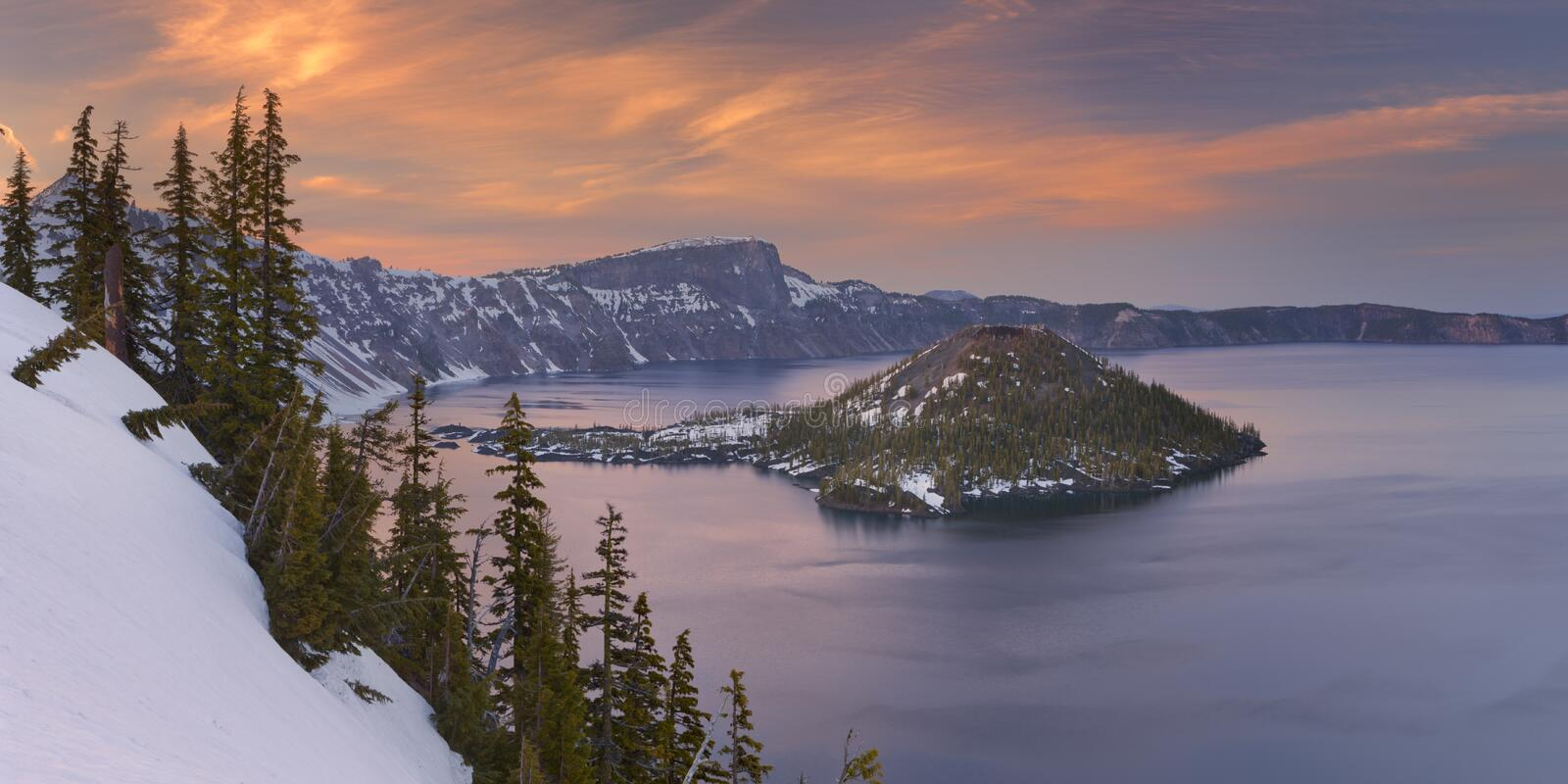 Wizard Island in Crater Lake in Oregon, USA at sunset stock photography