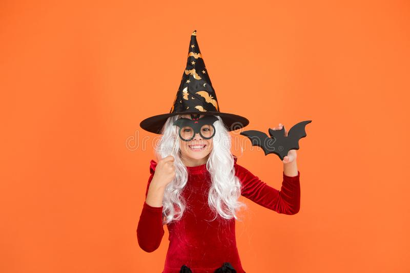 Wizard or magician. Halloween party. Photo booth props. Small girl in black witch hat. Autumn holiday. Join celebration. Little child in witch costume. Magical stock images