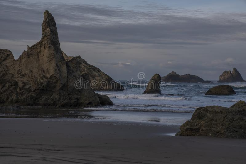 The Wizard`s Hat rock at Bandon Beach, Oregon stock photography