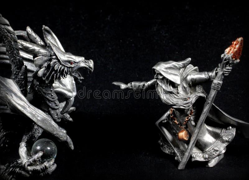 Wizard vs. Dragon royalty free stock photos
