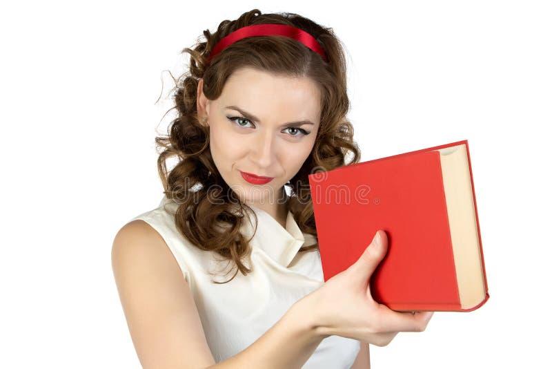 Wizerunek oferuje książkę pinup kobieta zdjęcie royalty free