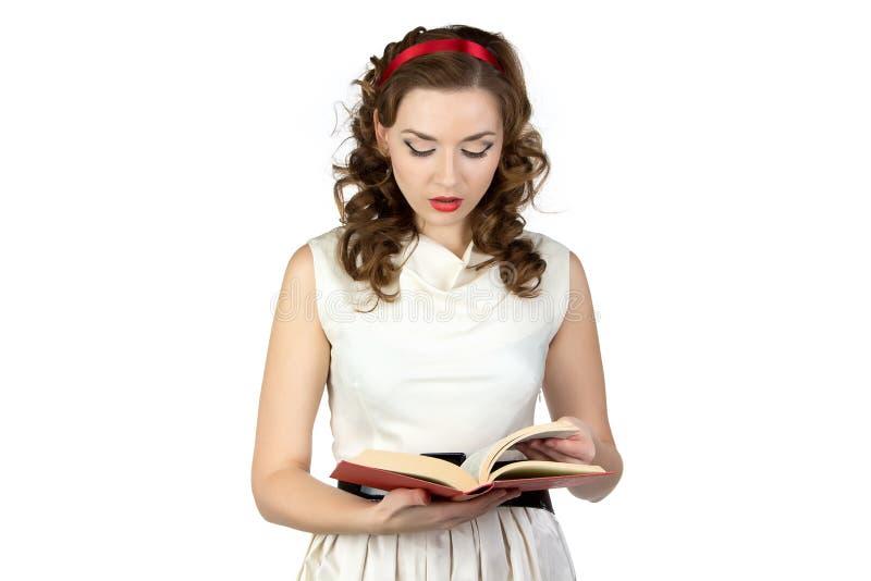 Wizerunek pinup kobiety czytelnicza książka zdjęcia royalty free