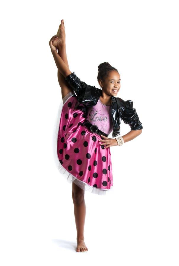 Wizerunek robi vertical rozłamowi elastyczna mała dziewczynka zdjęcie royalty free