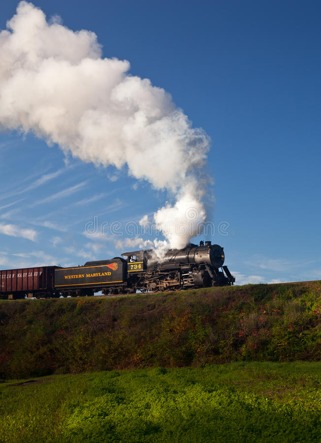 WM Steam train powers along railway stock images