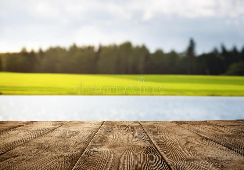 Wmpty wooden pier over the lake. Close up of old empty wooden pier over the lake with copy space stock photography