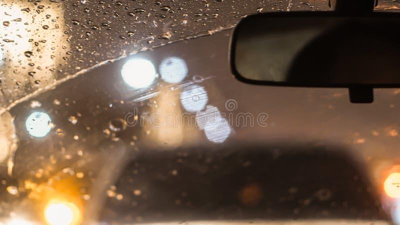 Wnętrze samochód gdy deszcz plama światło na drodze w pada dniu fotografia royalty free