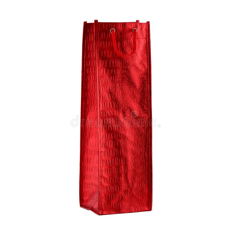 Wne red paper bag isolated on the white background. It is intended for shopping or for discounts and sales. It has a red cord, wine, package, container royalty free stock photos