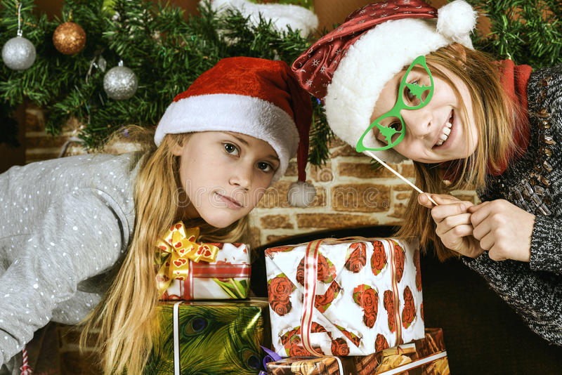Wo girls in Santa Claus costumes stock images