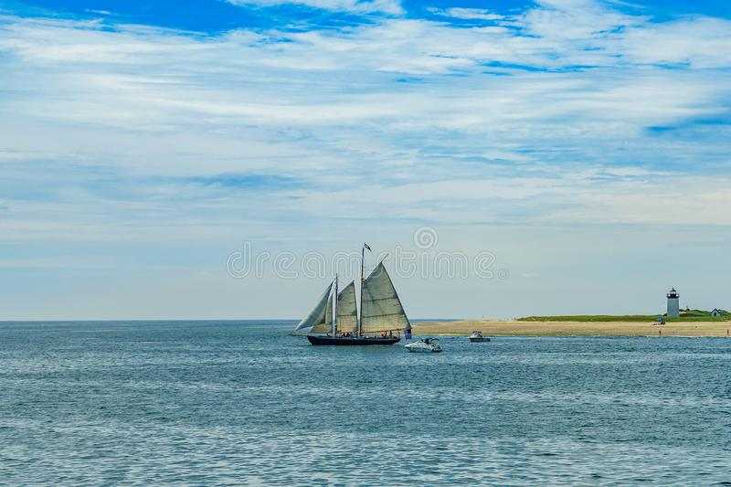 Wo-masted yacht and Beautiful landscape of ocean beach Cape cod Massachusetts. US stock photo