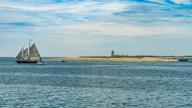 Wo-masted yacht and Beautiful landscape of ocean beach Cape cod. Massachusetts US royalty free stock images