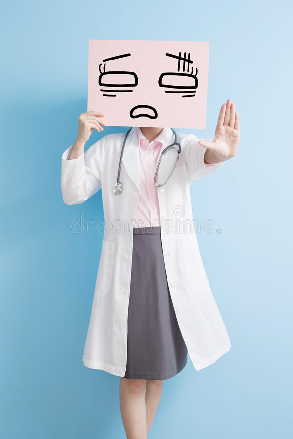 Woamn doctor take tired billboard. And show stop ,asian stock photos