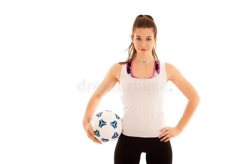 Woamn soccer player holds a ball isolated over white background stock photo