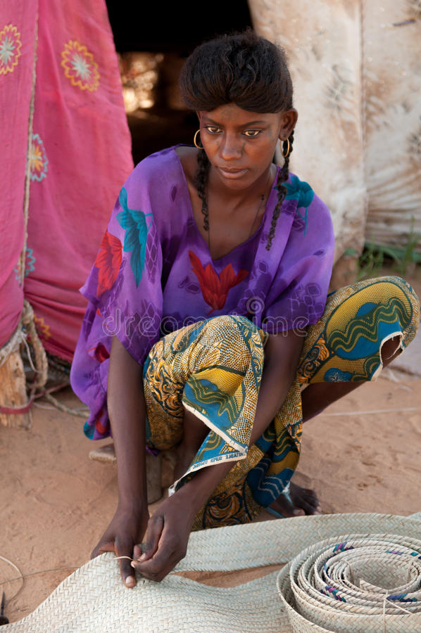 Wodaabe girl, Niger. Wodaabe woman sitting in front of her tent in nomadic camp near Agadez in Sahel region, Niger royalty free stock images