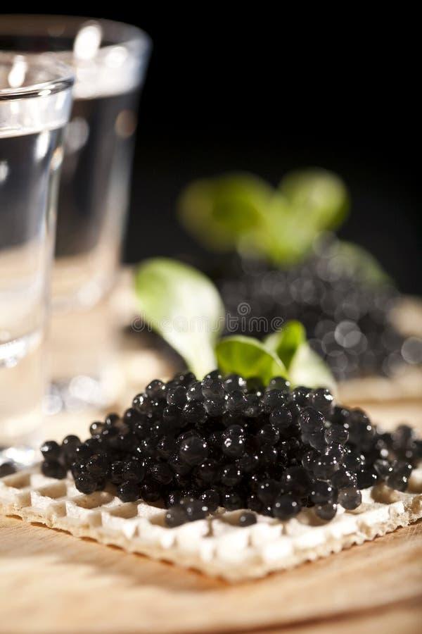 Wodka en zwarte kaviaar royalty-vrije stock afbeelding