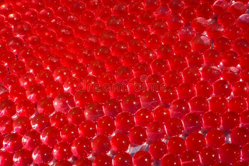 Wodne czerwone gel pi?ki z bokeh Polimeru gel Sylikatowy gel Piłki czerwony gel Krystaliczna ciek?a pi?ka z odbiciem czerwone jaj fotografia royalty free