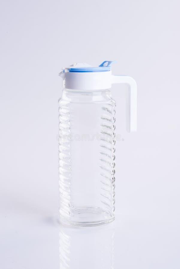 Wodny słój lub Pusty szklany słój na tle obraz stock