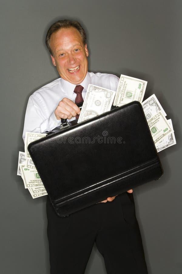 Wohlhabender Geschäftsmann lizenzfreie stockbilder