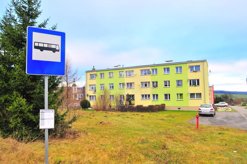 Wojborz, Poland, January 2018. Bust stop in front of post-communism tower block. stock image