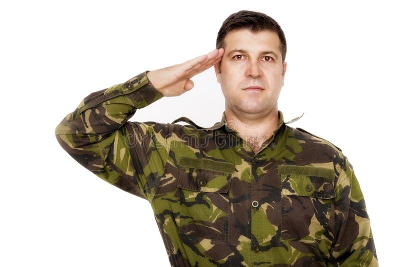 Wojsko żołnierza salutować odizolowywam obrazy stock